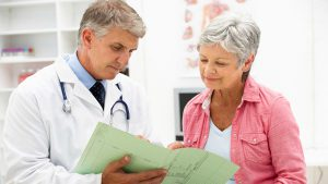 doctor giving patient medical results