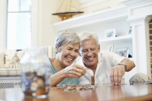 old couple happily counting savings