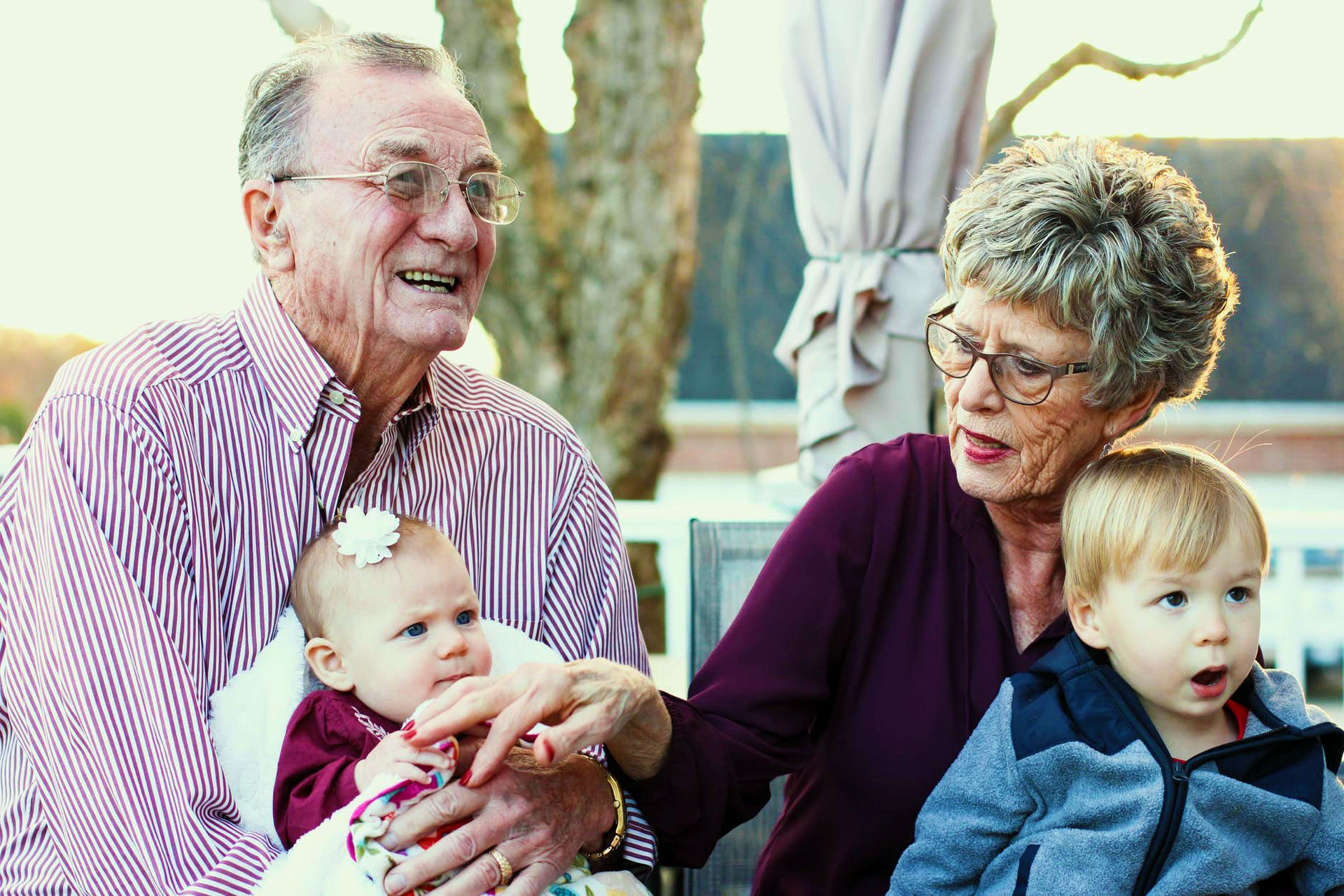 Grandpa and Grandma taking care of their grandchildren